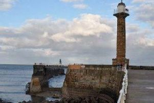 A bright orange wall on Whitbys iconic West Pier that caused an outcry in the historic town is to be replaced.