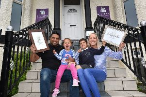 Whitby's Riviera Guesthouse has won  the seaview Guesthouse of the year Owners Zed and Emma Khan celebrate with children Aniya and Zak.pic richard ponter