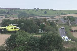The Yorkshire Air Ambulance and police at the scene. PIC: Robert Townsend