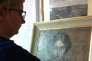 Pannett Art Gallery staff team member Lisa with the painting of Laura Knight.