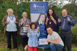 Members of the SWR Mind team celebrate the National Lottery windfall.