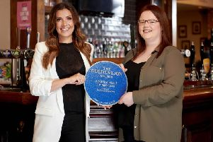Kym Marsh presenting a personalised blue plaque to publican Georgia at The Golden Lion