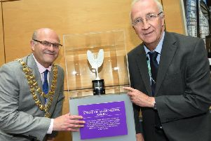 The Mayor of Wigan Coun Steve Dawber and leader of Wigan Council Coun David Molyneux with the Spirit of Manchester Award, on display at Wigan Library at Wigan Life Centre until 19th October