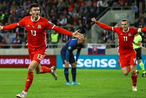 Kieffer Moore celebrates scoring his first goal for Wales in Slovakia