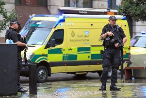 Armed police have the shopping centre on lockdown. Photo: PA