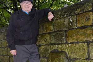 Coun George Davies would like a plaque to mark the Roman milestone, within the wall between Wigan Infirmary and The Elms, Wigan Lane