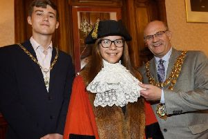 Bedford High School pupil Rachel Lawrence tries on the Mayoral robes, pictured in the Mayors Parlour with the Mayor of Wigan Coun Steve Dawber and consort Oliver Waite, left