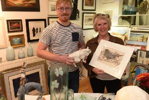 Zack and Lynne Higham at The Wigan Picture Framing Company.