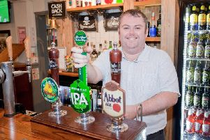 General manager Andrew Phillips behind the bar at The Venture