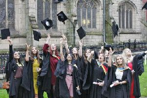 Graduands received their cap and gowns at the college before the traditional procession up Market Street