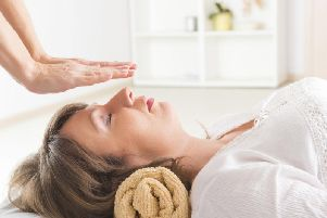 A Reiki session underway