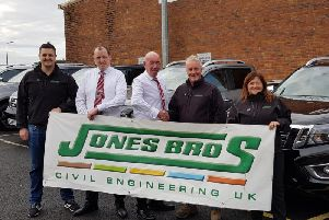 Jones Bros and Chorley Nissan staff after the civil engineering company took delivery of five new trucks