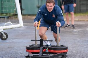 George Burgess pushing the weights