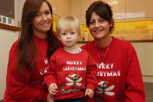 Beca Baggaley from Beca Jones Photography with son Georgie, two, and Emma Aspinall, who set up Do it 4 Loui in memory of her son Loui, pictured below