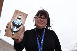 Tracey Rennox with her award for being a good neighbour