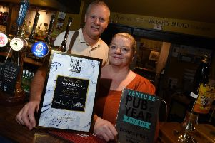 Tony and Janet Jones with their award