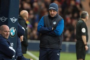 Paul Cook cuts a forlorn figure at Luton