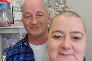 The couple sport their drastic buzz cuts