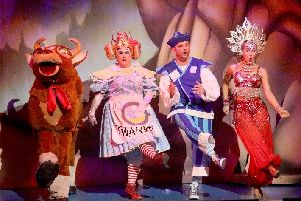 The panto cow, Widow Twankey (Si Foster), Wishee Washee (Scott Gallagher) and the Slave of the Ring (Jenna OHara) in Aladdin, at the Theatre Royal St Helens (Picture: David Munn)