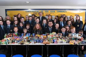 Some of the pupils who collected  hundreds of tins for The Brick