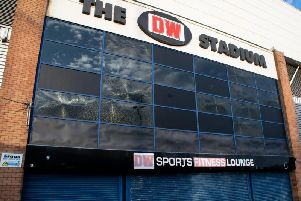 The smashed windows at the DW Stadium