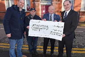 Members of the Atherton Community Trust with a cheque for 750.  Pictured are Coun Stuart Gerrard, Adrian DArcy from Noodleshake, trust chairman Norman Bradbury and MP James Grundy