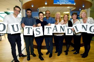 Dr Robert Lamb, Dr Arfan Saleemi, Dr Saira Zaman, Dr Ajay Mudugal, practice manager Karen Holgate, Jayne Williams, Gill Barker and Carol Moran, staff at Worsley Mesnes Health Centre celebrate being rated outstanding by the CQC