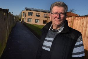 Local resident Bob Ward is concerned a path at the side of My Space residential unit, on the former site of Dray King pub is dangerous as cars are using it