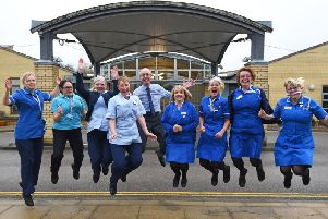Hospice staff leap for the start of the Helping Hand campaign to cover the cost of an extra days care on February 29