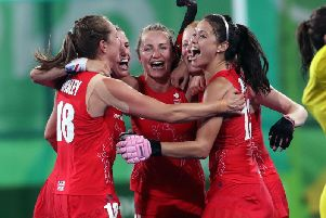 Great Britain's players celebrate at the end of the match following victory over New Zealand