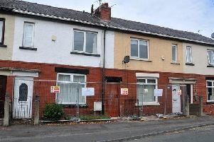 Exterior of 18 and 20 Wallace Lane, Whelley, Wigan - the two terraced houses are to be demolished because they have been built either side of a mine shaft