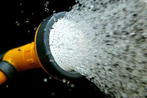 A temporary hosepipe ban restricts people from using hosepipes or sprinklers to water private gardens or wash cars.