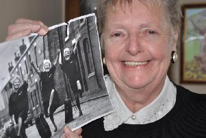 Enid Keats with the photograph of her, Liz Ramsdale and Sylvia Armstrong dancing on the Bird Street cobbles