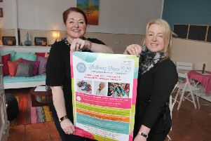 Kim Meehan and Lisa Morley, at Wellbeing Wigan CIC, celebrating the revamped cafe area