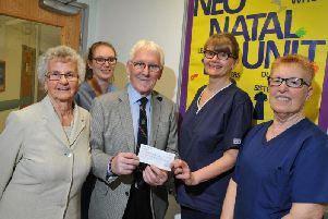 Coun John Hilton and wife Margaret present a 250 cheque to neo-natal staff Jenny Jennings, lead nurse Julie Armstrong and Sue Robinson