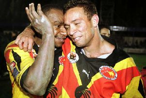 Adrian Lam and Stanley Gene celebrate after PNGs World Cup win against Tonga in 2000. Picture: Getty Images