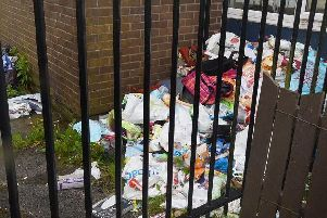 Mounting waste outside one property in Scafell Grove off Brecon Close