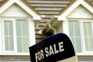 A sign showing a house up for sale