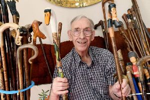 Frank Walton and his collection of walking sticks