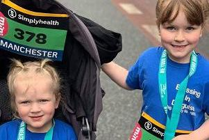 Evana Parkinson, four, with big sister Erica, five, at the Great Manchester Run