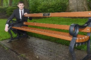 Former councillor Nathan Murray with the bench in memory of ex-Wigan Council employee Kevin Mulkeen