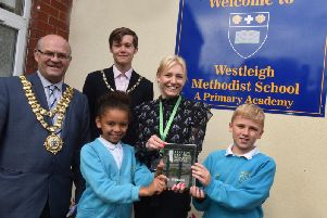 The Mayor of Wigan Coun Steve Dawber and consort Oliver Waite with head teacher Amy Burkes and pupils