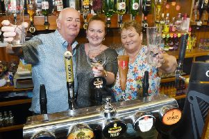 David and Marie Coleman have been in charge at St Thomas Sports and Social Club in Marsh Green for 30 years and have been helped out by their granddaughter Samantha Hardman who is pictured centre