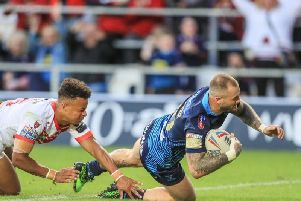 Zak Hardaker scores the try of the night but Wigan were well beaten at St Helens