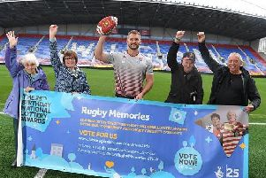 Wigan Warriors captain Sean OLoughlin, visiting the National Lottery funded project Rugby Memories, to support their bid to be named Best Community & Charity Project in the 25th Birthday National Lottery Awards
