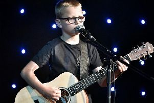Singer and guitarist Kai Berry, nine, shows off his skills