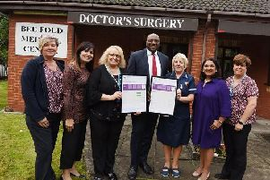 Staff at Bee Fold Medical Centre celebrate being awarded outstanding by the CQC, from left, receptionist Stephanie Jones, regional manager Victoria Westwood, office manager Tania Berry, Dr Adeyinka Adejumo, nurse Janet Raftry, Dr Shikha Pitalia and receptionist Alison Aspden