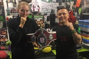 Eleanor Coulson and coach Chris Boyle with her national belt.
