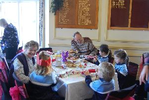 Ranby House pupils enjoy their festive tea with residents of Charter Court