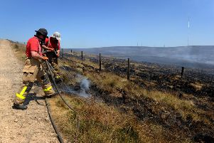 Firefighters from Lancashire and other forces have spent a week tackling a huge moorland fire on Winter Hill near Bolton, Lancashire, which was started deliberately. Picture: Paul Heyes.
